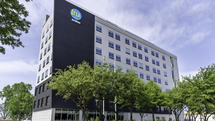 The Tru by Hilton Hotel on Stemmons Freeway is across from the Infomart.