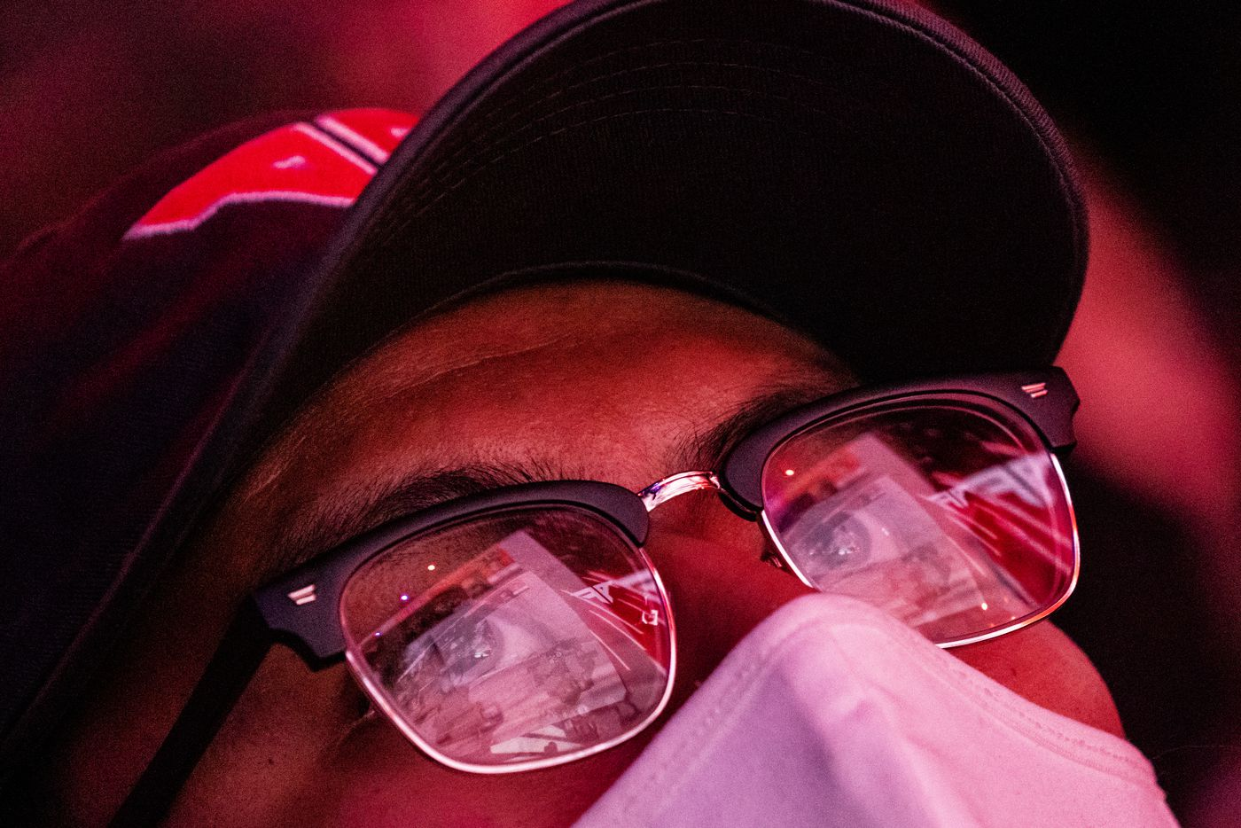 An Atlanta FaZe fan has the competition reflect in his glasses as he looks on during the Call of Duty league playoffs championship round at the Galen Center on Sunday, August 22, 2021 in Los Angeles, California. The Atlanta FaZe beat the Toronto Ultra 5 - 3. (Justin L. Stewart/Special Contributor)