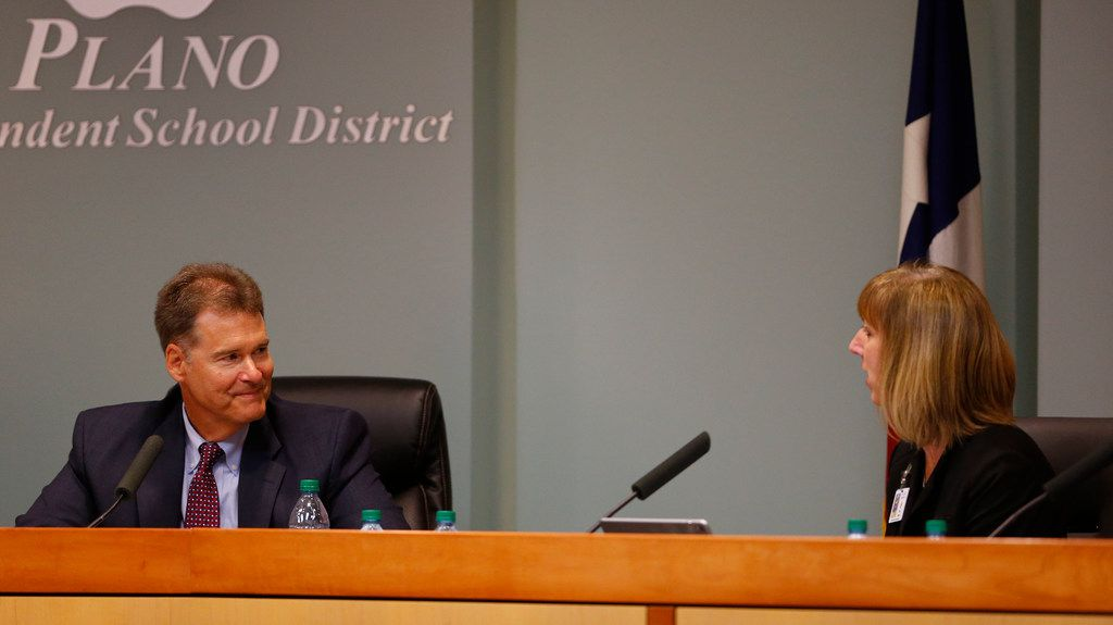 Plano ISD Superintendent Brian Binggeli receives compliments after resigning from board member Sara Bonser in Plano ISD boardroom in Plano, Texas on Nov. 28, 2017. The Plano ISD Superintendent has submitted his resignation after a little more than 2 years with the district. Bonser will take over as the interim.  (Nathan Hunsinger/The Dallas Morning News)