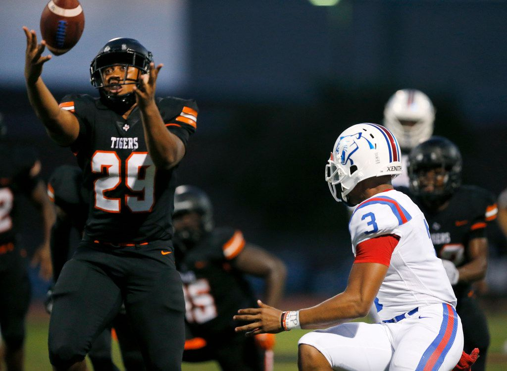 Duncanville quarterback Ja'Quinden Jackson (3) lost the grip on the ball turning it over to Lancaster's James Grace (32) during the second quarter at Beverly D. Humphrey Tiger Stadium in Lancaster Texas, Friday, August 30, 2019. (Tom Fox/The Dallas Morning News)