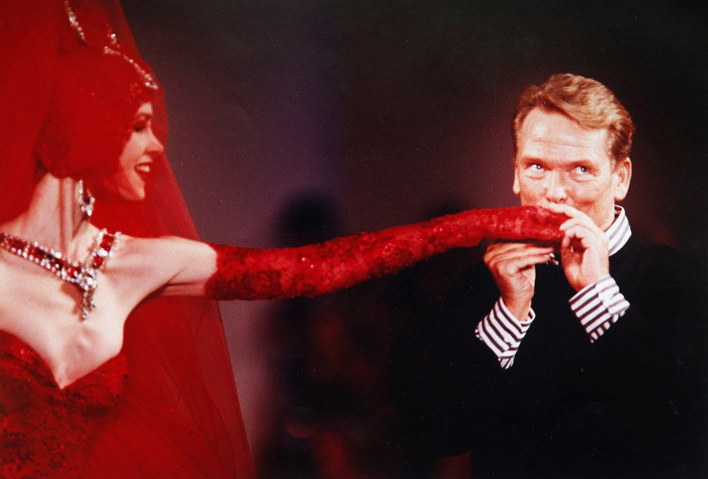 Jan Strimple gets a kiss from American fashion designer Bob Mackie on the runway in the early 1990s. (Photo courtesy of Jan Strimple)