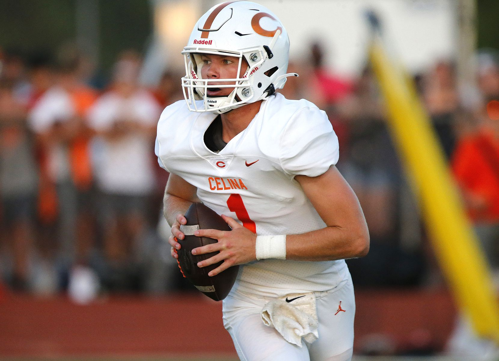 Celina High School quarterback Noah Bentley (1) rolls out to pass during the second half as Melissa High School hosted Celina High School at Cardinal Field in Melissa on Friday night, August 27, 2021. (Stewart F. House/Special Contributor)