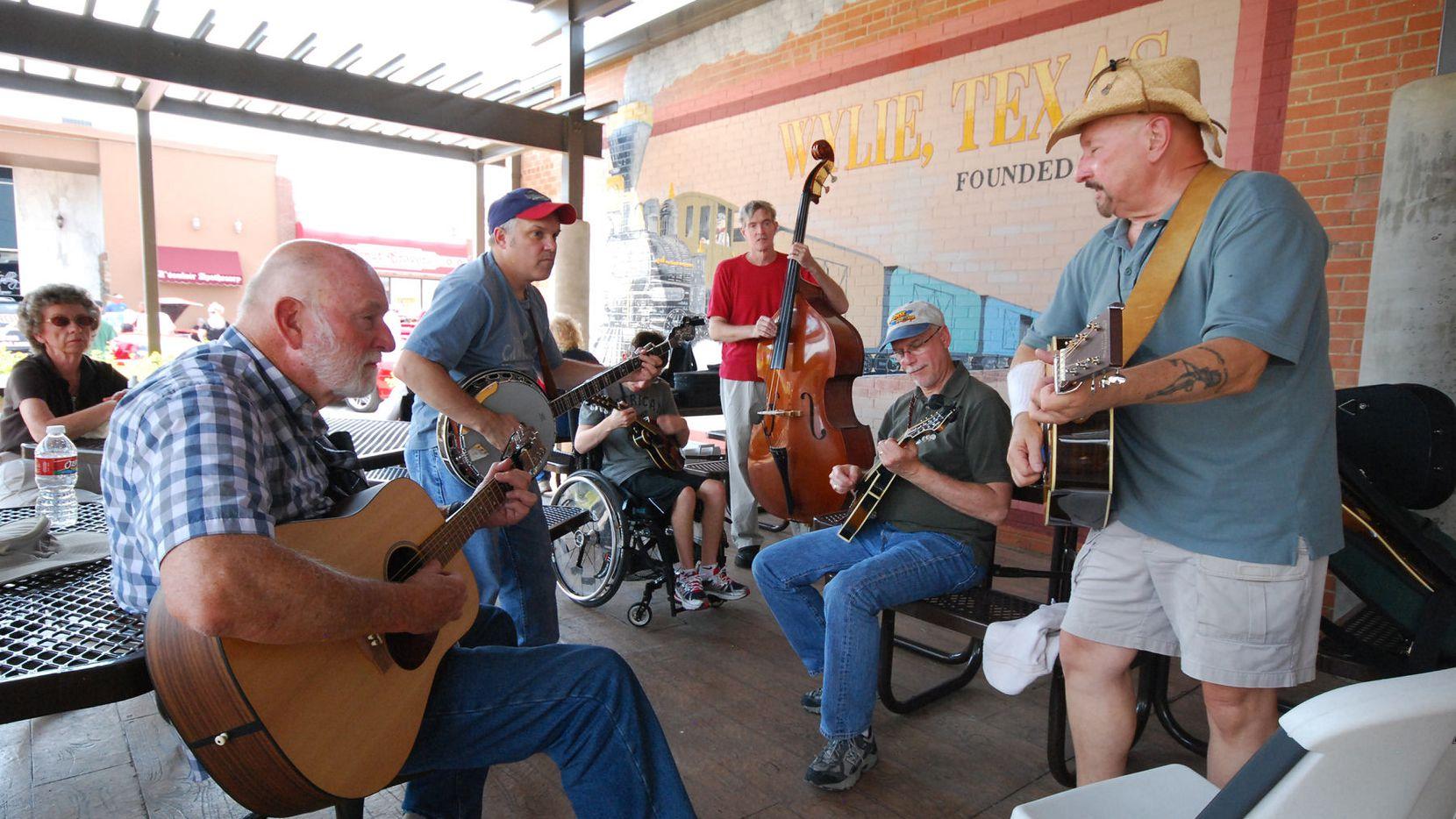 Musicians perform during Bluegrass on Ballard in downtown Wylie.