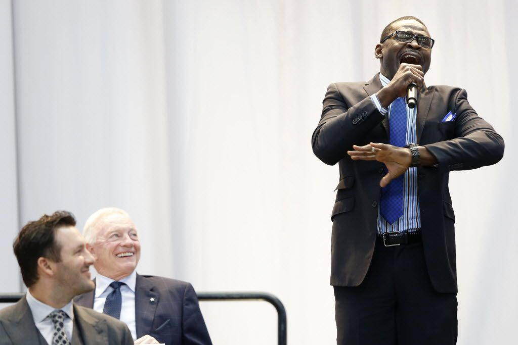 Dallas Cowboys player Michael Irvin speaks next to Dallas Cowboys quarterback Tony Romo (9) and Dallas Cowboys owner Jerry Jones before presenting fellow teammate Emmitt Smith with the Tom Landry Legends Award during the 2015 Flowserve Dallas Cowboys Kickoff Luncheon at AT&T Stadium in Arlington, on Wednesday, September 2, 2015. (Vernon Bryant/The Dallas Morning News)