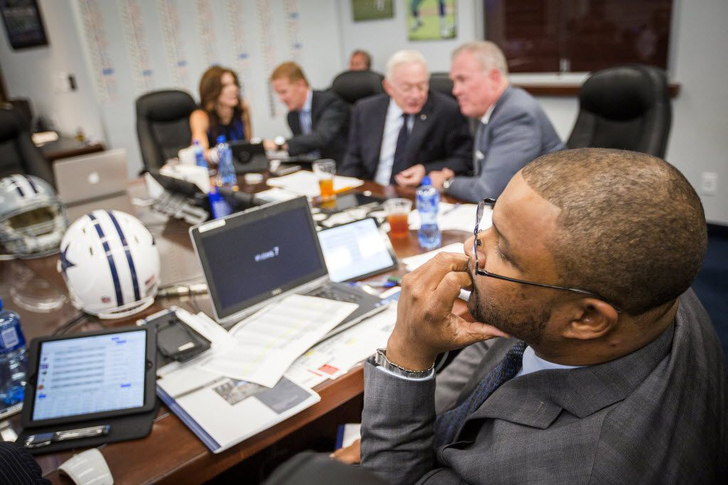 """Dallas Cowboys assistant director of player personnel Will McClay watches early picks in the team's """"War Room"""" at their training facility at Valley Ranch on the first day of the NFL Draft, Thursday, April 30, 2015, in Irving, Texas. Executive vice president Charlotte Jones Anderson, head coach Jason Garrett, owner Jerry Jones and executive vice president/COO Stephen Jones are in the background from left to right. (Smiley N. Pool/The Dallas Morning News)"""