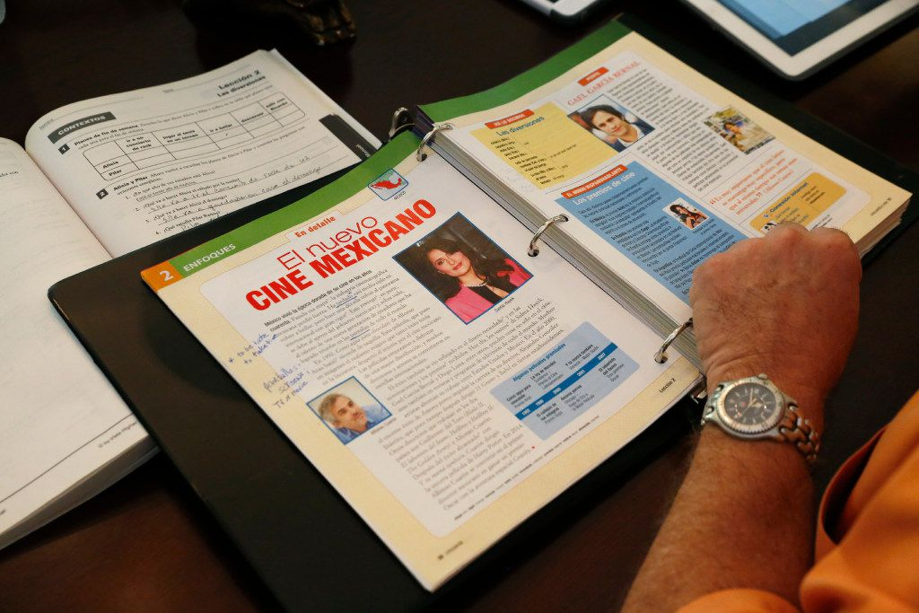 Lance Rogers, 61, read from his test book as he has a private Spanish lesson in his Dallas home from Alba Melo-Carvajal, Thursday June 8, 2017. He has taken Spanish lessons for 6-7 years to help him communicate with workers in his homebuilding business. (Ron Baselice/The Dallas Morning News))