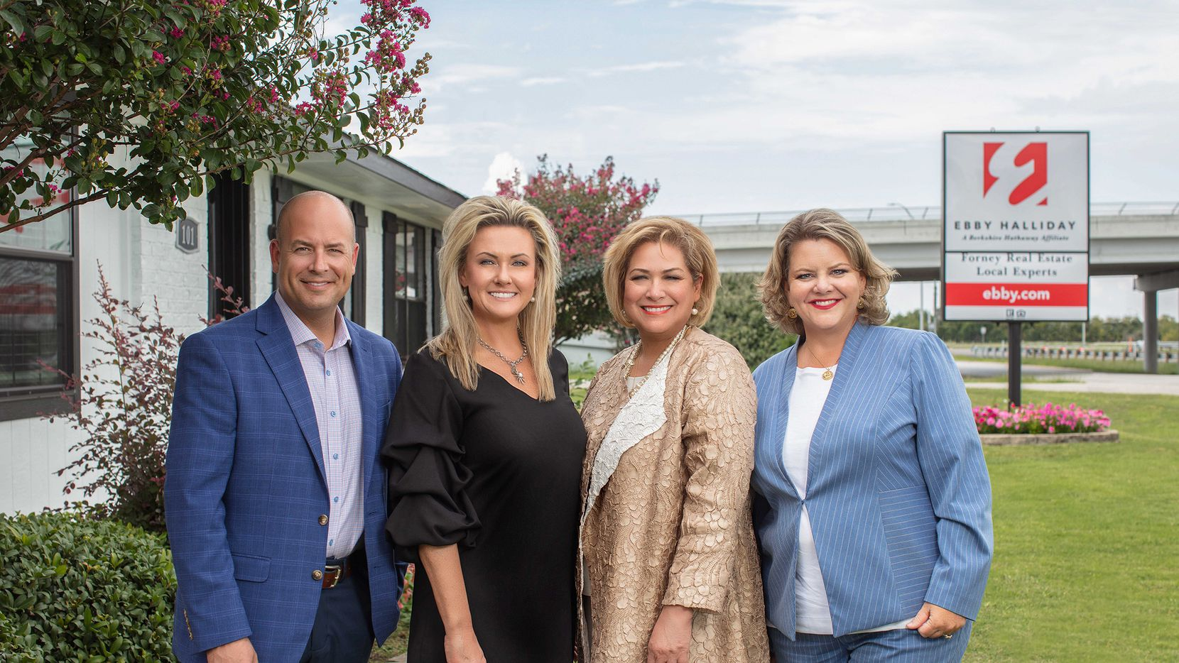 From left, president and CEO Chris Kelly, Forney co-sales leaders Natalie Jackson Thomas and Sylvia Sotelo Kidd and vice president of Brokerage Malinda Howell celebrate the opening of the new Forney office.