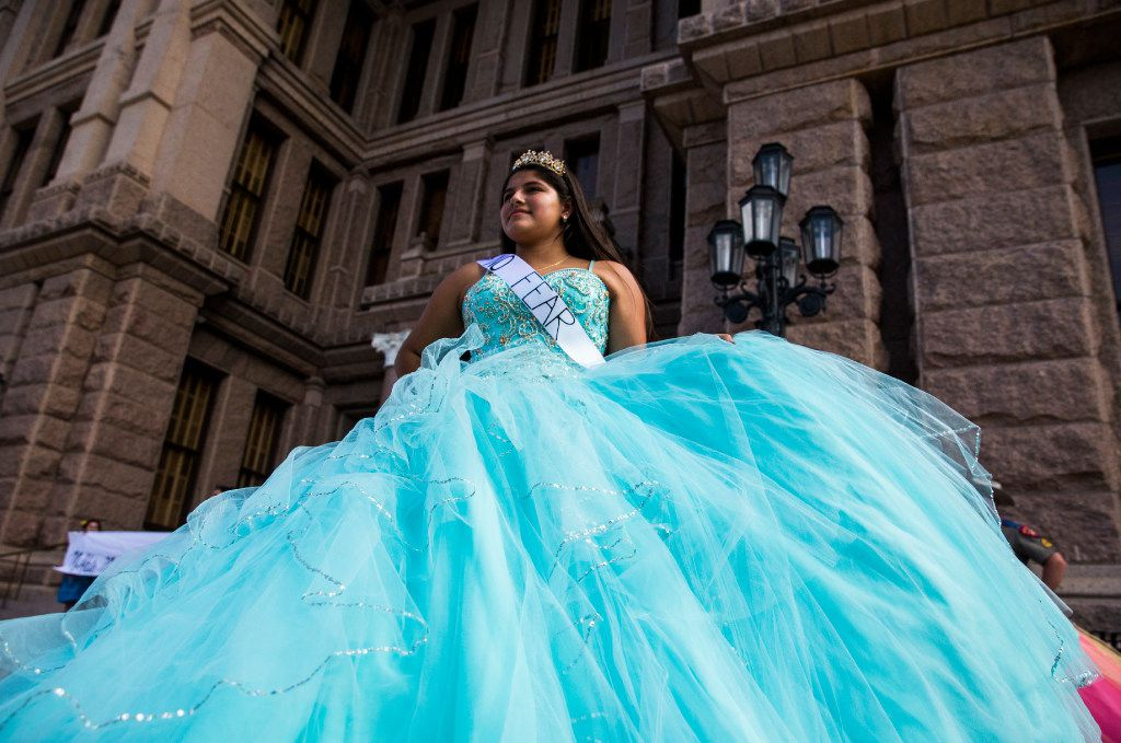 Kaitlyn Barrientos performs as she and other teenage girls with Jolt Texas hold symbolic quinceaneras to protest the sanctuary cities ban on Wednesday outside the Texas Capitol in Austin.