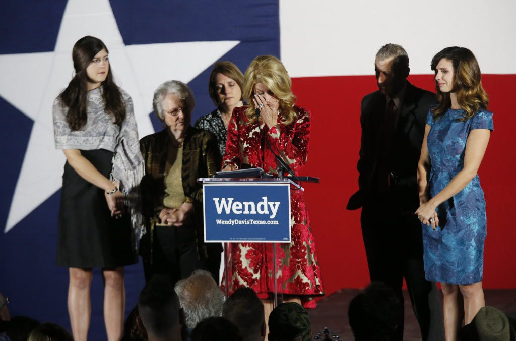 Gubernatorial candidate Wendy Davis cried as she talked about her supporters during an election night watch party at Times Ten Cellars in Fort Worth on Nov. 4, 2014.  She is pictured with her daughter Dru Davis, mother Ginger Russell,  sister Jennifer James,  brother Joey Russell and daughter Amber Davis.