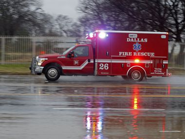 A Dallas Fire-Rescue ambulance heads off to a call on a cold rainy morning in Dallas on Jan. 2, 2019.