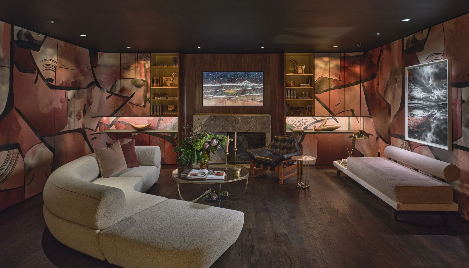 Yates Desygn crafted an entertaining area on the basement level of the 2021 Kips Bay Decorator Show House Dallas. The room has ample living space and lounging areas, a kitchen and a dedicated game table. Making the most of the lack of windows on the basement level, the design team used moody lighting and rosy hues to create a welcoming feel.