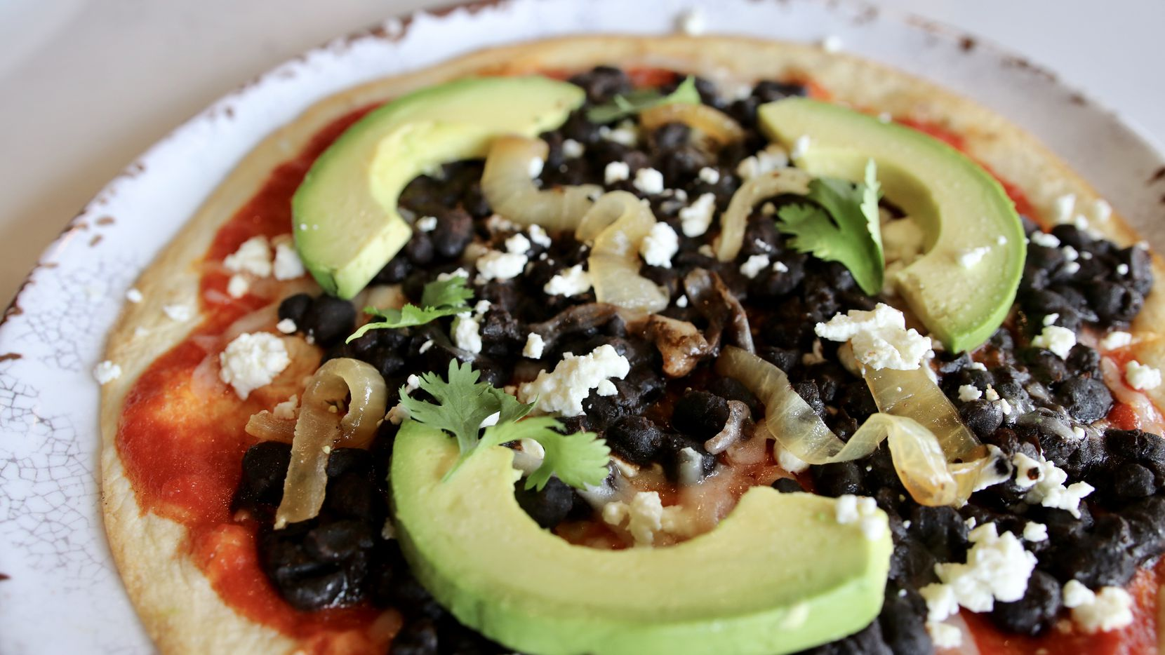 One of the new items on Fireside Pies' menu in fall 2020 is Oaxacan clayuda with black beans, queso fresco and avocado. Dallas chef Stephan Pyles created it.