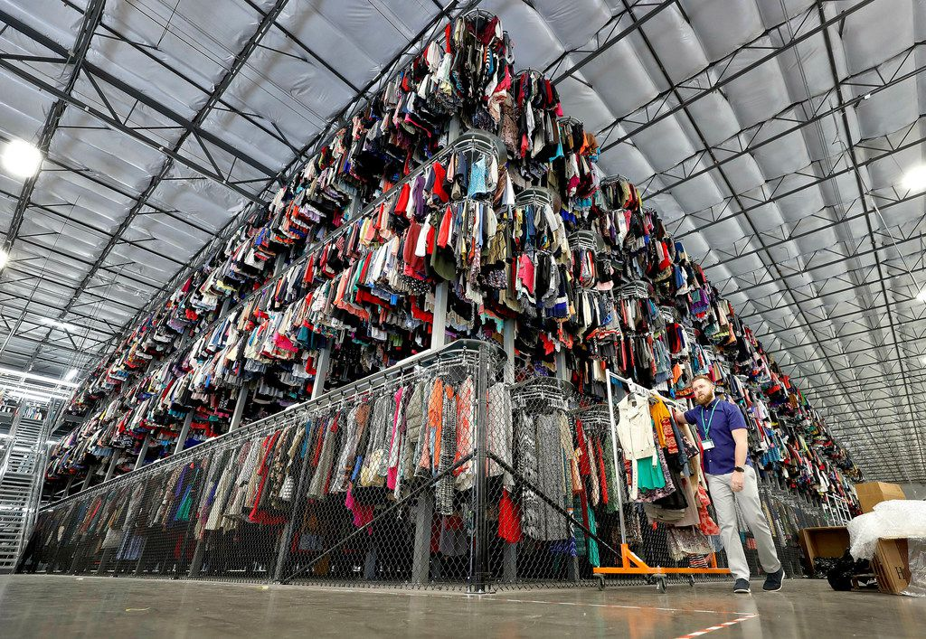 One of Walmarts newest initiatives is a partnership with ThredUp, a consignment and thrift store. This sorting facility in Phoenix shows some of the thousands of garments in the ThredUp inventory.