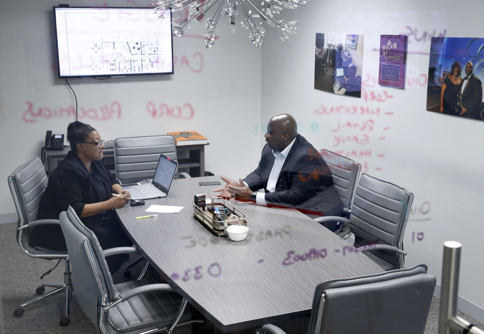 Crowther Group CEO Thomas Crowther works with his accounting manager, Adrienne Soders, in their North Dallas office.