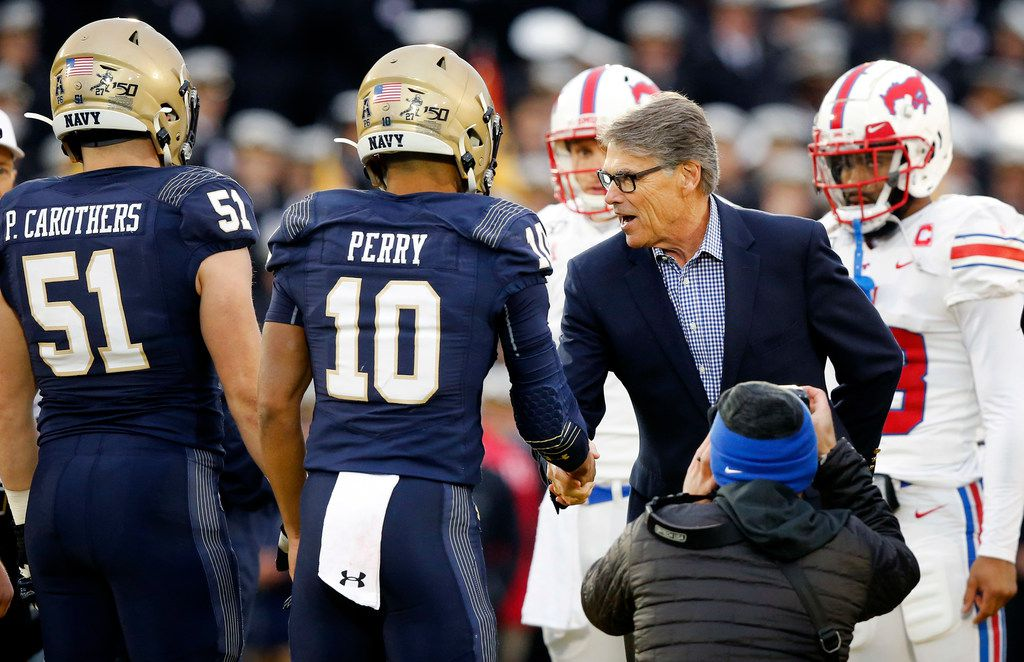 Department of Energy Secretary Rick Perry shakes hands with Navy Midshipmen captain Malcolm Perry (10) before the coin toss with the Southern Methodist Mustangs at Navy-Marine Corps Memorial Stadium in Annapolis, Maryland, Saturday, November 23, 2019. (Tom Fox/The Dallas Morning News)