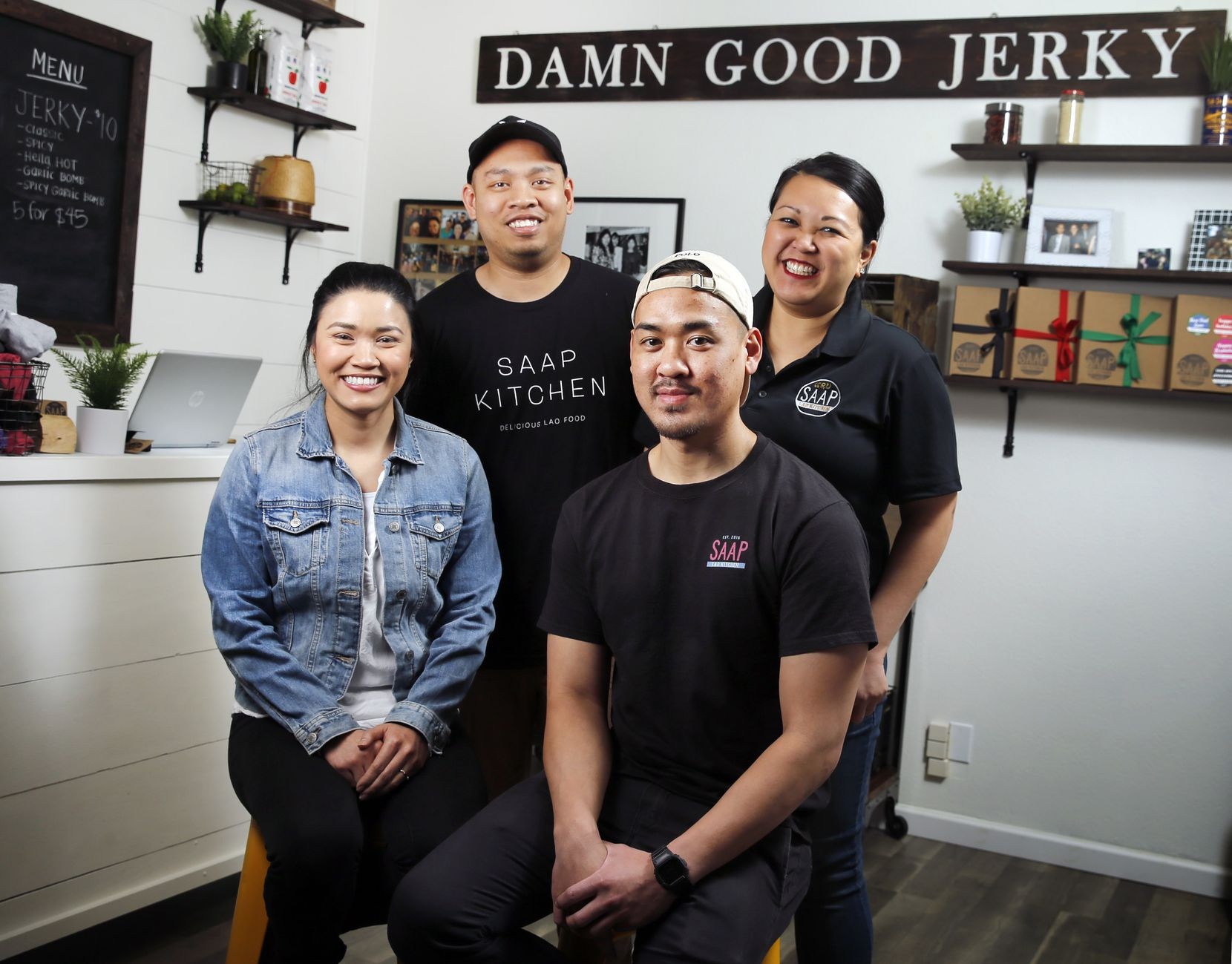 Co-founders (from left) Sandy Sichanh, Elson Douangdara, Frick Chanthorn and Kim Chanthorn pose at Saap Lao Kitchen, a family-owned, Laotian-style beef jerky company based in Bedford, Texas.