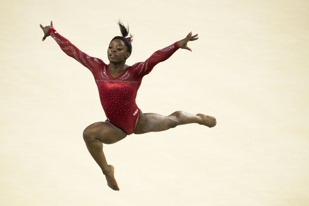 USA gymnast Simone Biles of Houston practices her floor exercise routine during a training session at the Rio Olympic Arena on the day before the opening ceremonies of the Rio 2016 Olympic Games on Thursday, Aug. 4, 2016, in Rio de Janeiro.