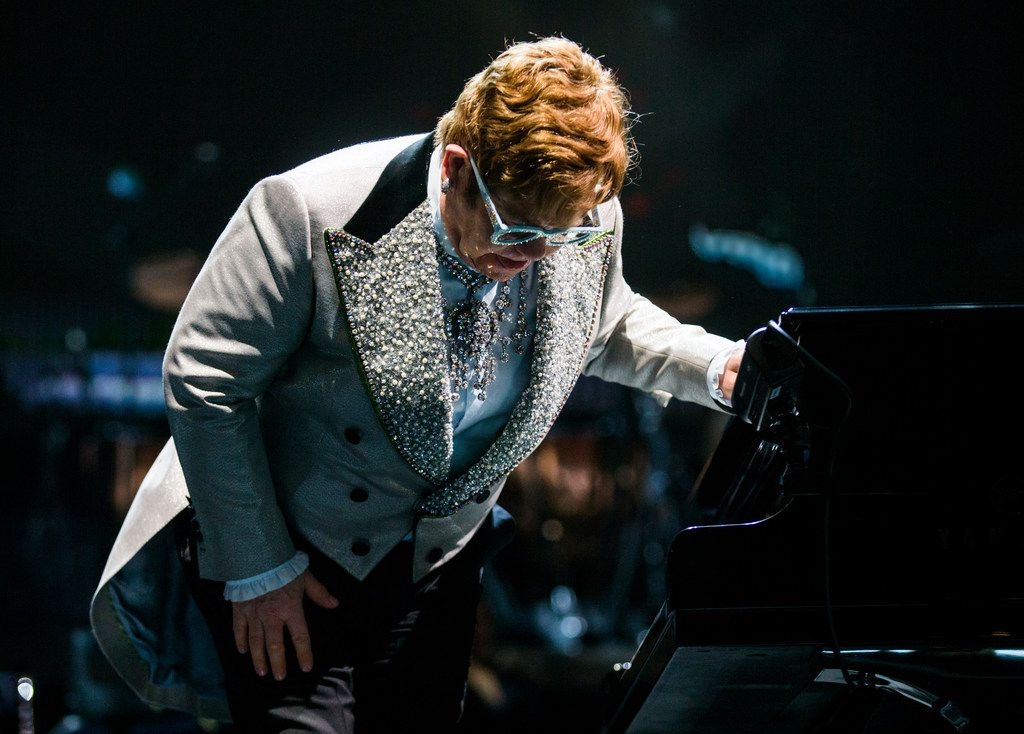 """Elton John performs """"Bennie and the Jets"""" at American Airlines Center in Dallas on Friday, December 14, 2018 during his Farewell Yellow Brick Road tour. (Ashley Landis/The Dallas Morning News)"""