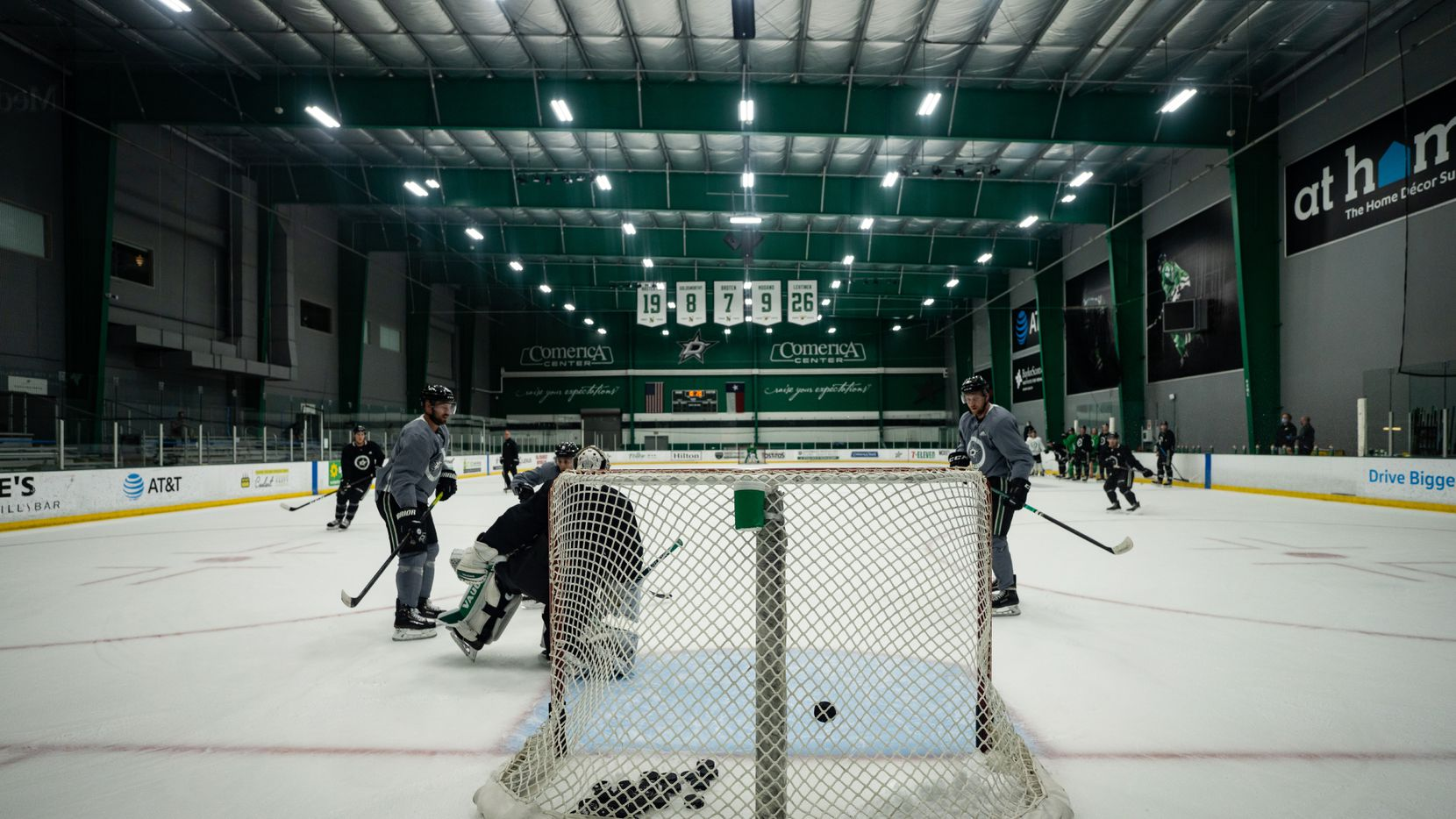 Blake Comeau (left) and Tyler Seguin (right) take shots at Dallas Stars' first training camp practice during the NHL restart on Monday, July 13.
