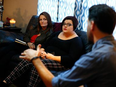 Deanna Staton (left) and Kati Wall listen to one of their lawyers Jamal Alsaffar at Kati's house in Floresville, Texas on Nov. 29, 2017. The sisters lost their grandparents/parents Dennis and Sara Johnson during the shooting at First Baptist Church of Sutherland Springs on Nov. 5, 2017. The family is one of several who has decided to file a claim against the U.S. Air Force for negligence connected to the shooting.