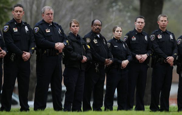 About 30 police officers, mostly from Irving, stood silently outside the Walls Unit in Huntsville during George Rivas' execution.
