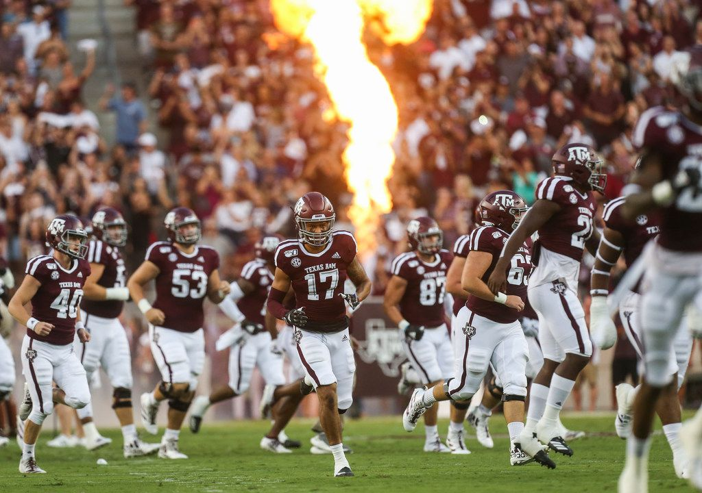 The Texas A&M Aggies break onto the field prior to a college football game between Texas A&M and Texas State on Thursday, Aug. 29, 2019 at Kyle Field in College Station, Texas.