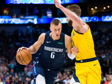 Dallas Mavericks forward Kristaps Porzingis (6) gets past Indiana Pacers forward Domantas Sabonis (11) during the second quarter of an NBA game between the Indiana Pacers and the Dallas Mavericks on Sunday, March 8, 2020 at American Airlines Center in Dallas.
