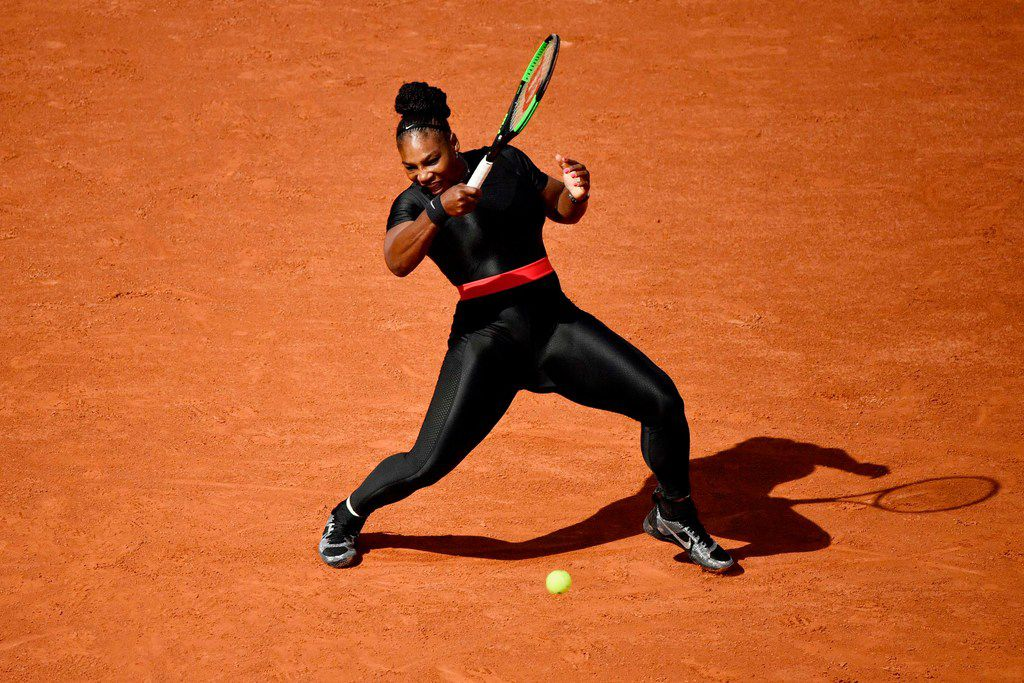In this file photo taken on May 29, 2018 Serena Williams plays a forehand return to Czech Republic's Kristyna Pliskova during their women's singles first round match on day three of the Roland Garros 2018 French Open tennis tournament in Paris.