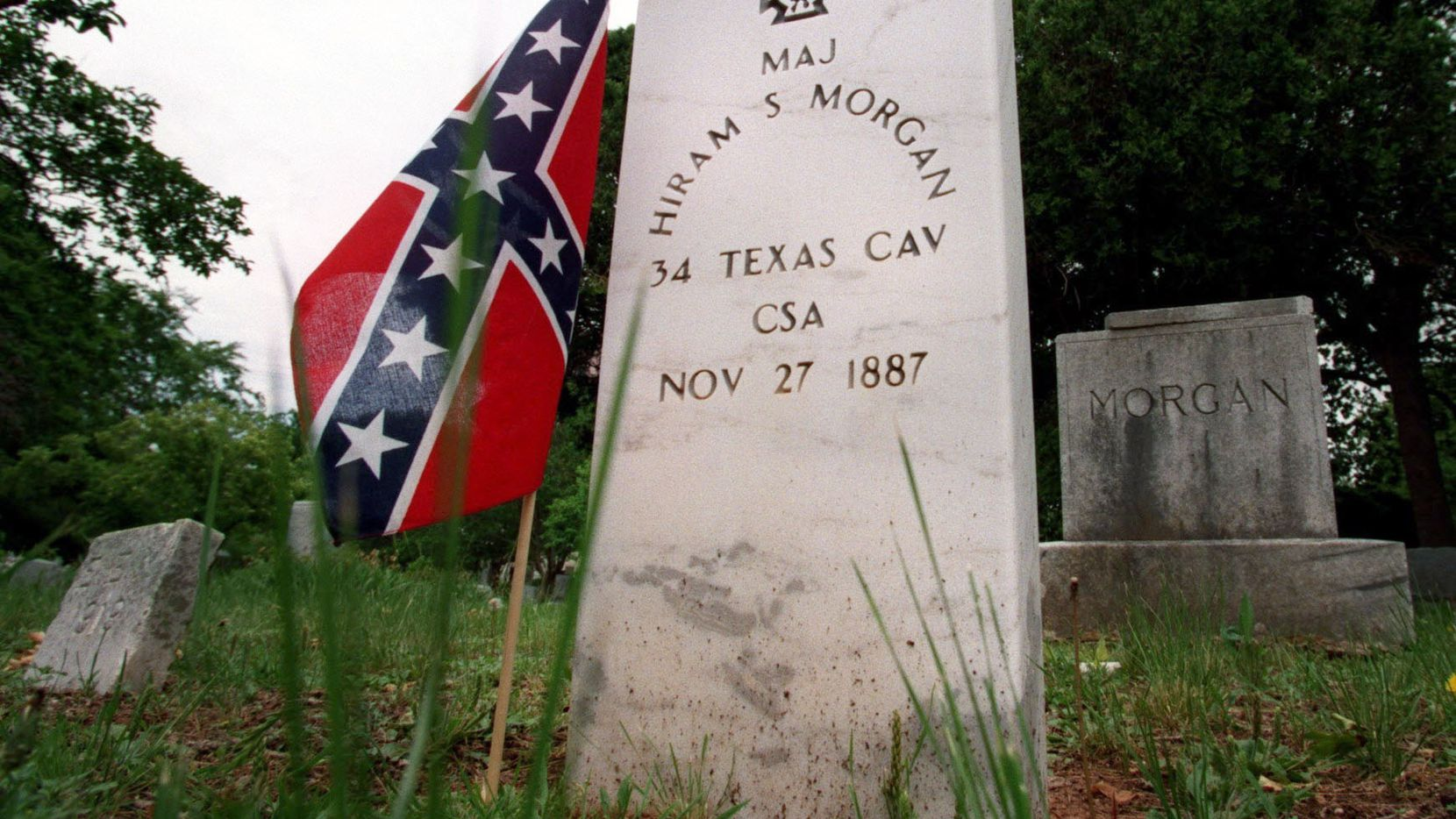 The headstone of confederate soldier Major Hiram S. Morgan is decorated with the confederate flag at Greenwood Cemetery north of downtown Dallas.  The Daughters of the Confederacy help to decorate Greenwood Cemetery by placing confederate flags next to the graves of the confederate soldiers and United States flags next to the graves of soldiers who served the United States in the Civil War.