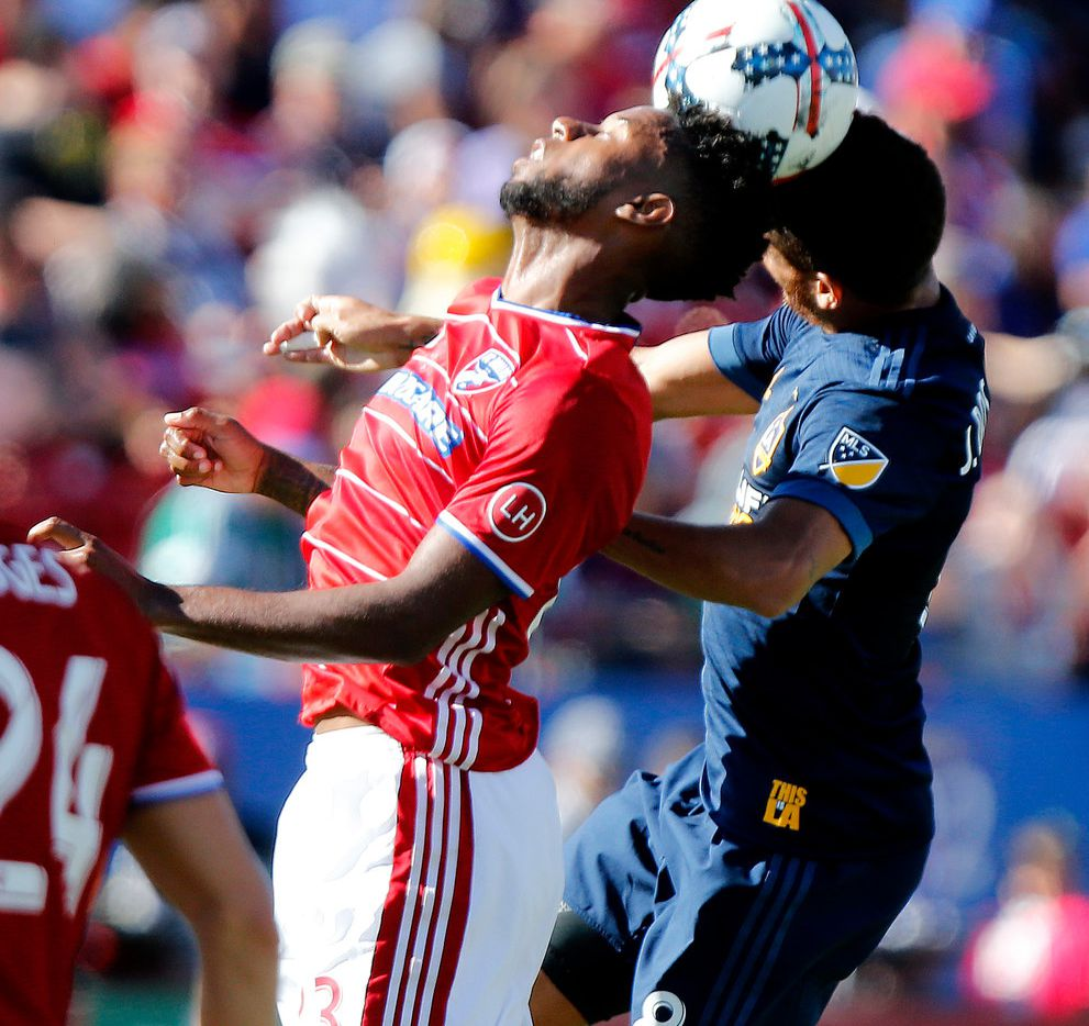 FC Dallas midfielder Kellyn Acosta (23) and Los Angeles Galaxy midfielder Jonathan dos Santos (8) compete for a header during the first half as FC Dallas hosted the Los Angeles Galaxy at Toyota Stadium in Frisco on Sunday afternoon, October 22, 2017. (Stewart F. House/Special Contributor)