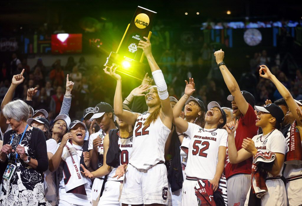 South Carolina Gamecocks forward A'ja Wilson (22) hoists the winning trophy after defeating the Mississippi State Lady Bulldogs, 67-55, in the NCAA Women's Final Four championship game at the American Airlines Center in Dallas, Sunday, April 2, 2017. Wilson was named the most outstanding player of the tournament. (Tom Fox/The Dallas Morning News)