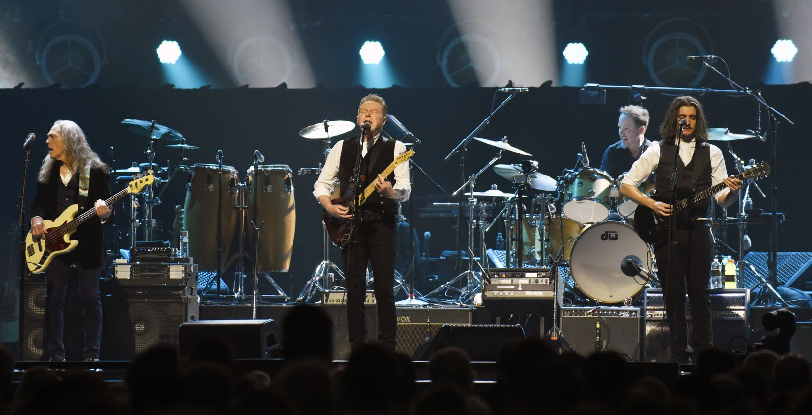 Don Henley, center, performs with other members of the American rock band the Eagles at the American Airlines Center in Dallas, Saturday night Feb. 29, 2020.
