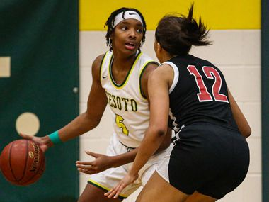 DeSoto's Sa'Myah Smith (5) tries to protect the ball against Duncanville's Zaria Rufus (12) during a basketball game in DeSoto on Saturday, January 23, 2021.