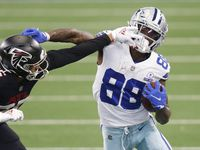 Cowboys wide receiver CeeDee Lamb (88) stiff-arms Falcons cornerback Isaiah Oliver (26) during the second half of a game at AT&T Stadium in Arlington on Sunday, Sept. 20, 2020.