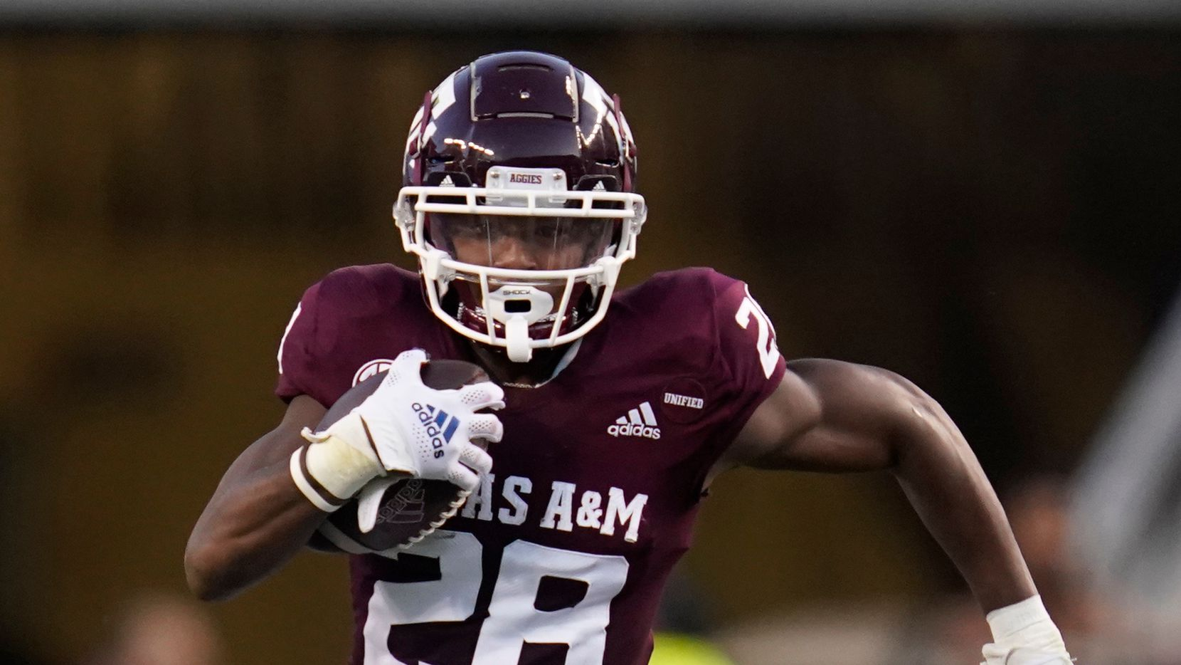 Texas A&M running back Isaiah Spiller (28) breaks to the outside against Kent State for a first down run during the first quarter of an NCAA college football game on Saturday, Sept. 4, 2021, in College Station, Texas.