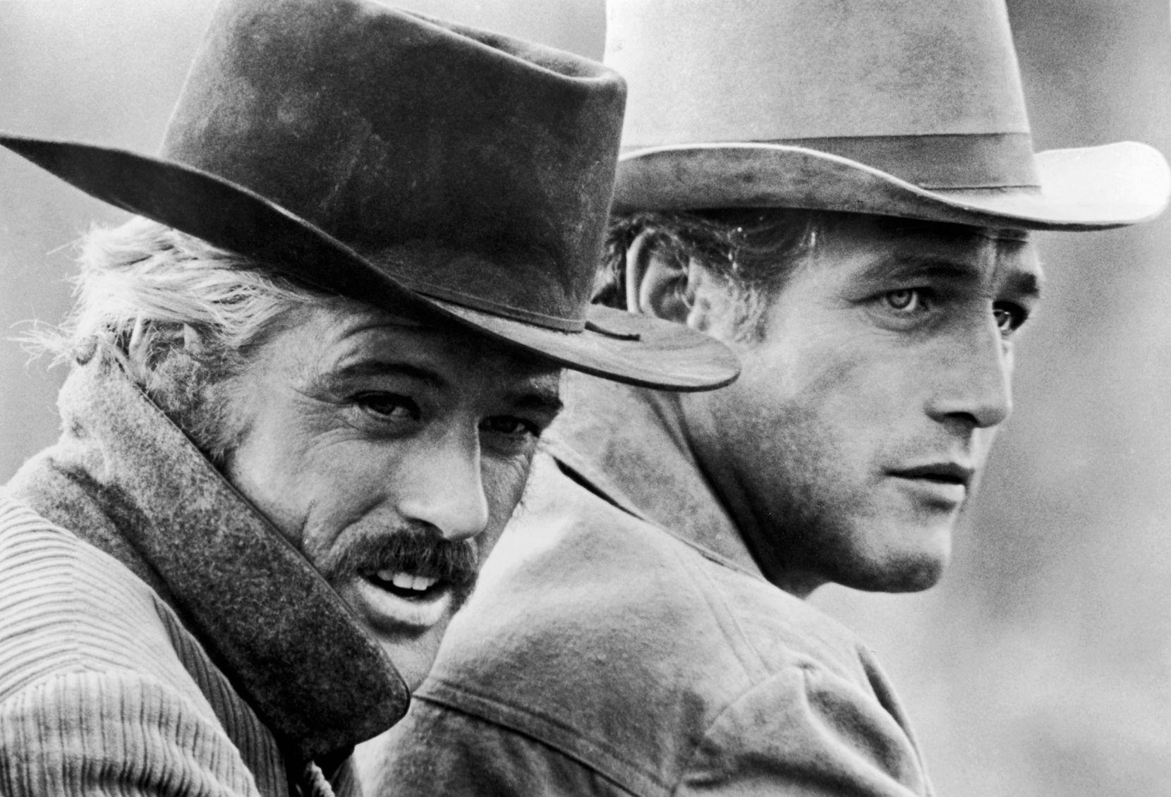 """""""Raindrops Keep Falling On My Head"""" became immortalized in the film """"Butch Cassidy and the Sundance Kid"""" by accompanying a scene in which Butch (played by Paul Newman, at right) shows off his bicycling skills. Co-star Robert Redford (left) was critical of the song's use in the film, noting the scene's lack of rain. """"How wrong I was,"""" he later said."""