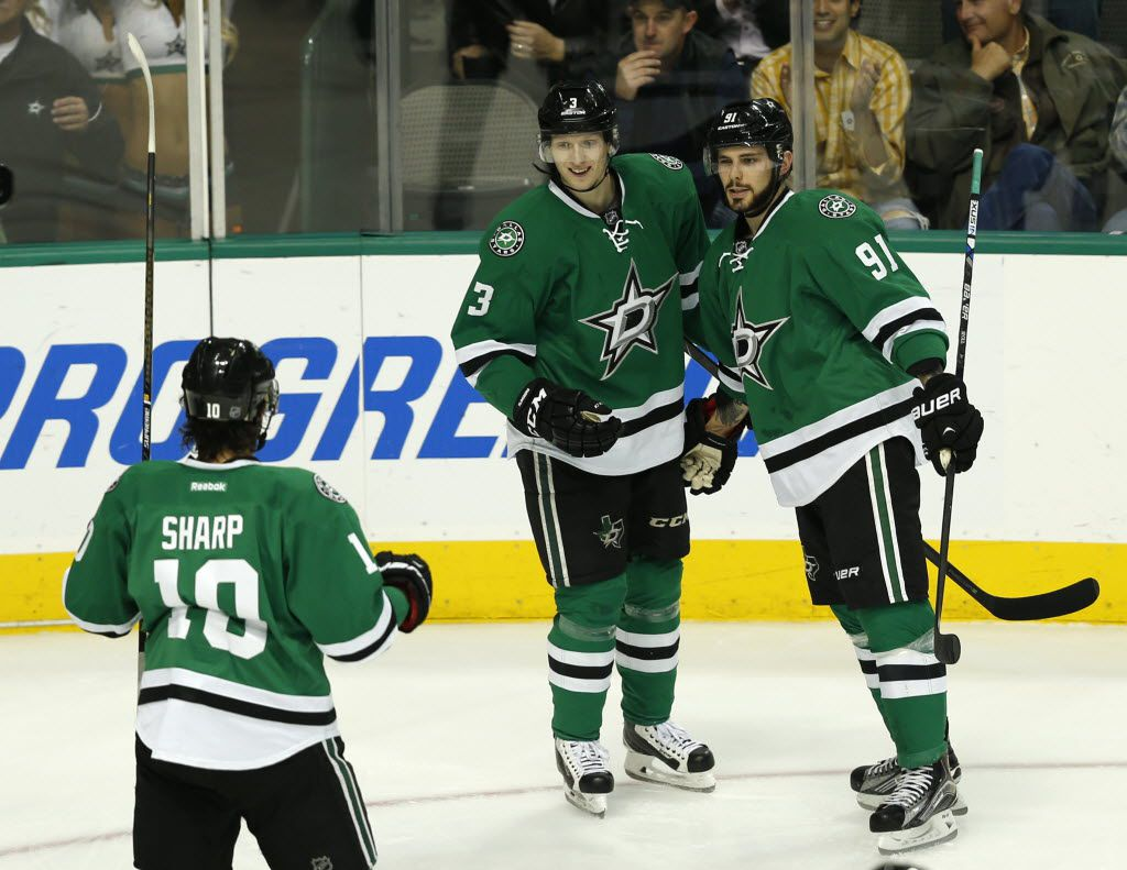 Dallas Stars center Tyler Seguin (91), Dallas Stars defenseman John Klingberg (3) and Dallas Stars left wing Patrick Sharp (10) celebrate after Sequin scored a goal during the first period at the American Airlines Center in Dallas on Jan. 7, 2016. (Rose Baca/The Dallas Morning News)