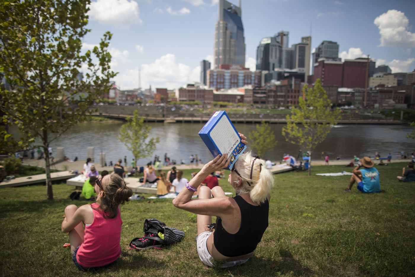 People watch the solar eclipse along the Cumberland River in Nashville, Tenn., which falls in the path of totality. For the first time since 1918, a solar eclipse traveled across the entire U.S. on Monday.