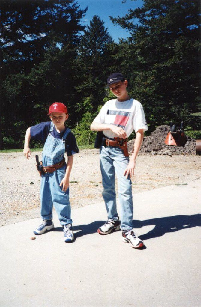 Jonathan Crews (right) and his younger brother show off their new guns during a visit to Montana to see their grandfather.