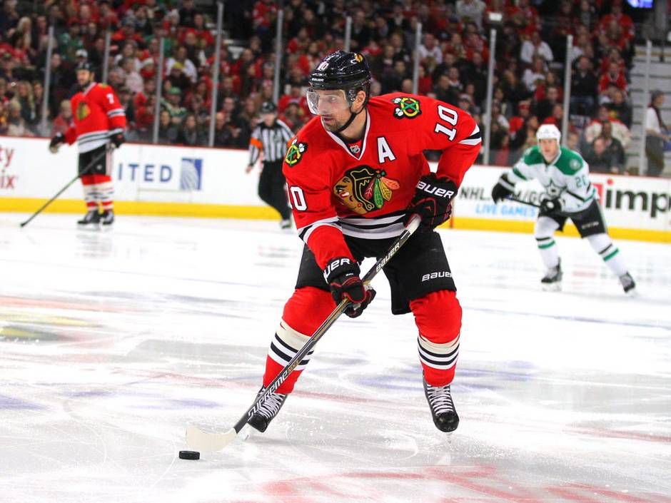 Jan 4, 2015; Chicago, IL, USA; Chicago Blackhawks left wing Patrick Sharp (10) with the puck during the first period against the Dallas Stars at the United Center. Mandatory Credit: Dennis Wierzbicki-USA TODAY Sports