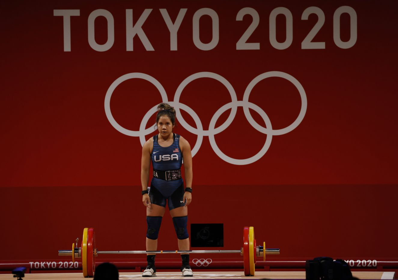 USA's Jourdan Delacruz prepares to lift 108 kg on her third attempt in the clean and jerk round during the women's 49 kg weightlifting final during the postponed 2020 Tokyo Olympics at Tokyo International Forum on Saturday, July 24, 2021, in Tokyo, Japan. Delacruz received a no-lift on all three attempts of the clean and jerk round. (Vernon Bryant/The Dallas Morning News)