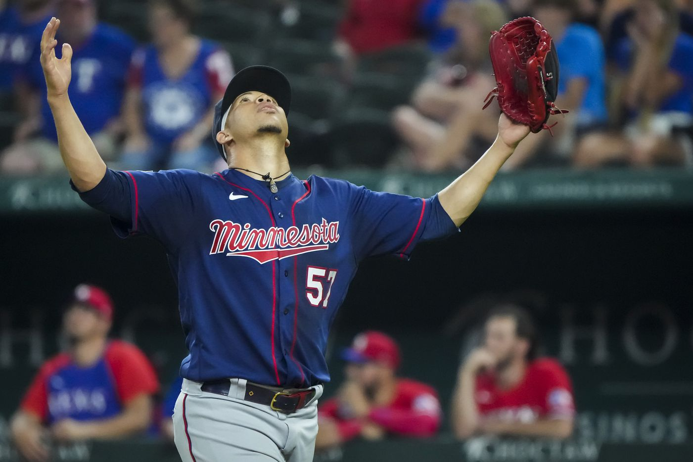 Minnesota Twins relief pitcher Hansel Robles reacts after recording the final out of the ninth inning against the Texas Rangers at Globe Life Field on Friday, June 18, 2021.