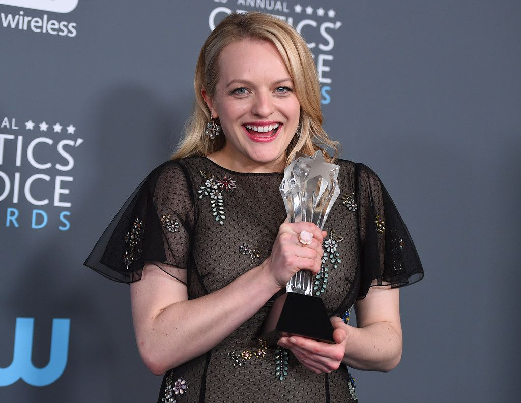 """Elisabeth Moss, winner of the award for best actress in a drama series for """"The Handmaid's Tale"""", poses in the press room at the 23rd annual Critics' Choice Awards at the Barker Hangar on Thursday, Jan. 11, 2018, in Santa Monica, Calif."""