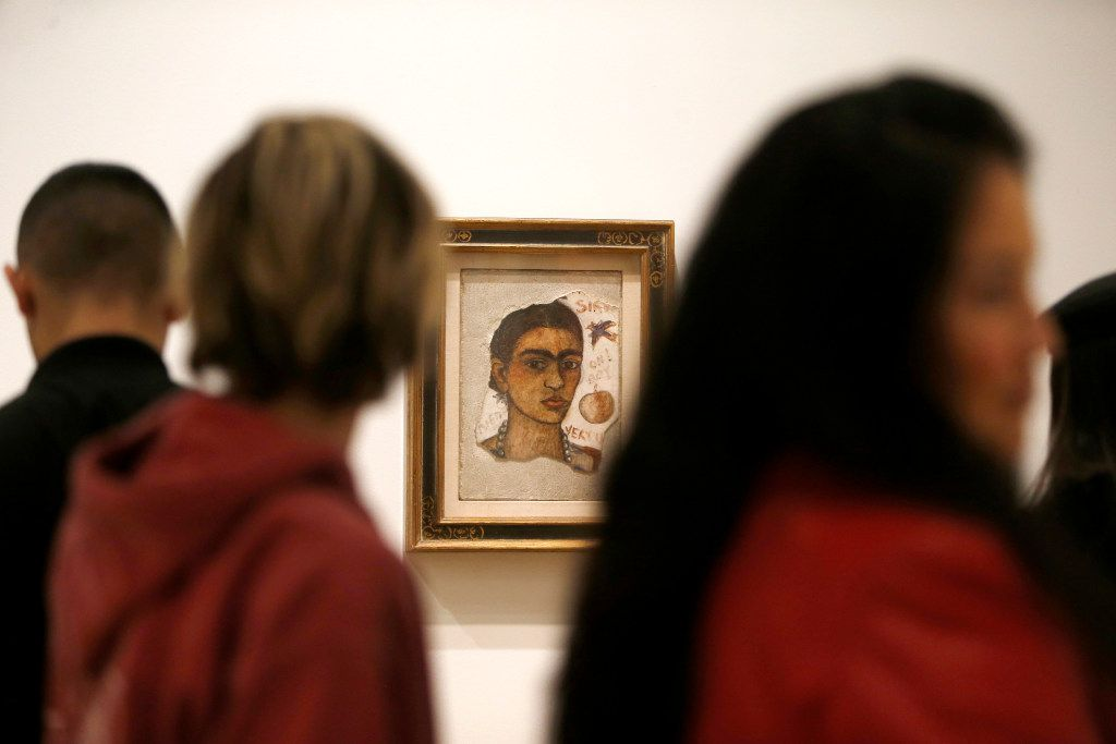 "Crowds move past ""Self-Portrait, Very Ugly"" by Frida Kahlo in the ""Mexico 1900-1950"" exhibition at the Dallas Museum of Art"
