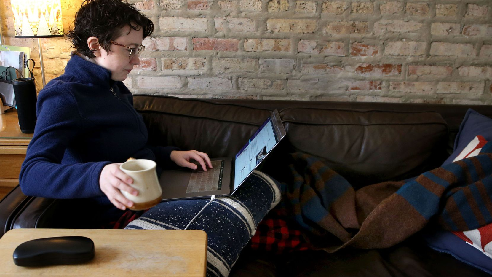 Glitch.com software engineer Melissa McEwen, 33, works from her Logan Square neighborhood home on March 12. She has worked remotely for five years.