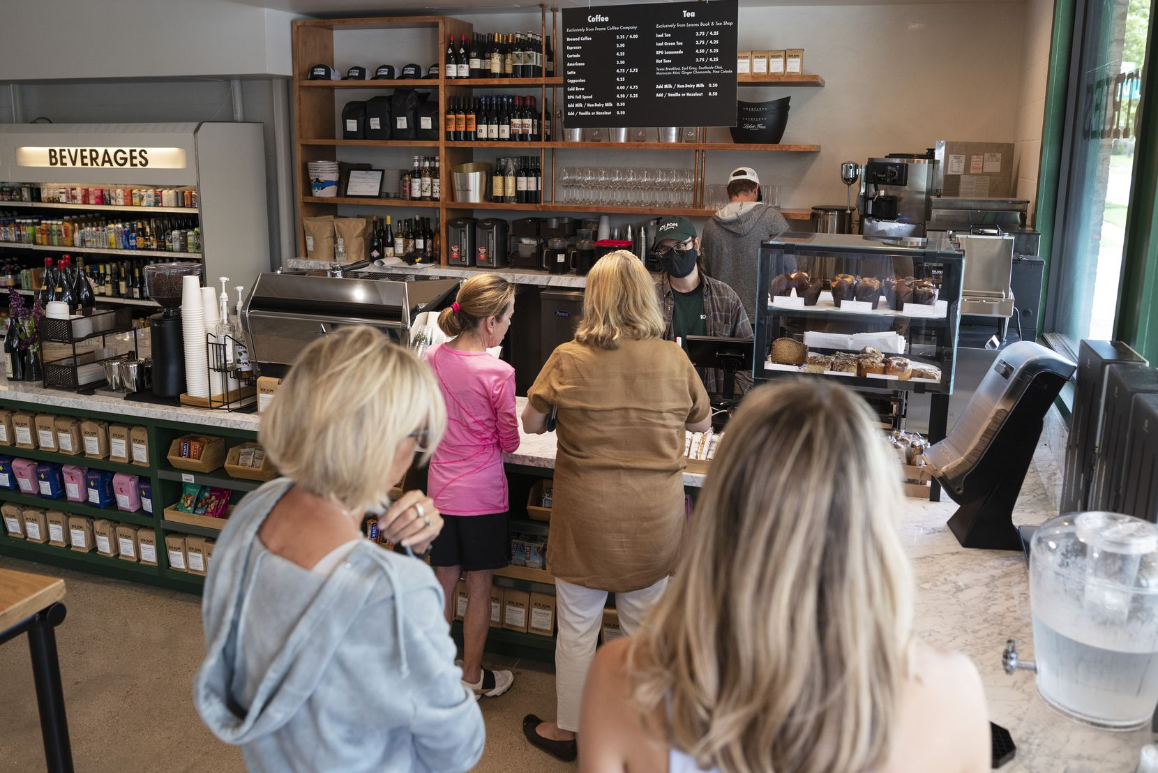 Customers wait to order at the new coffee shop and wine bar.