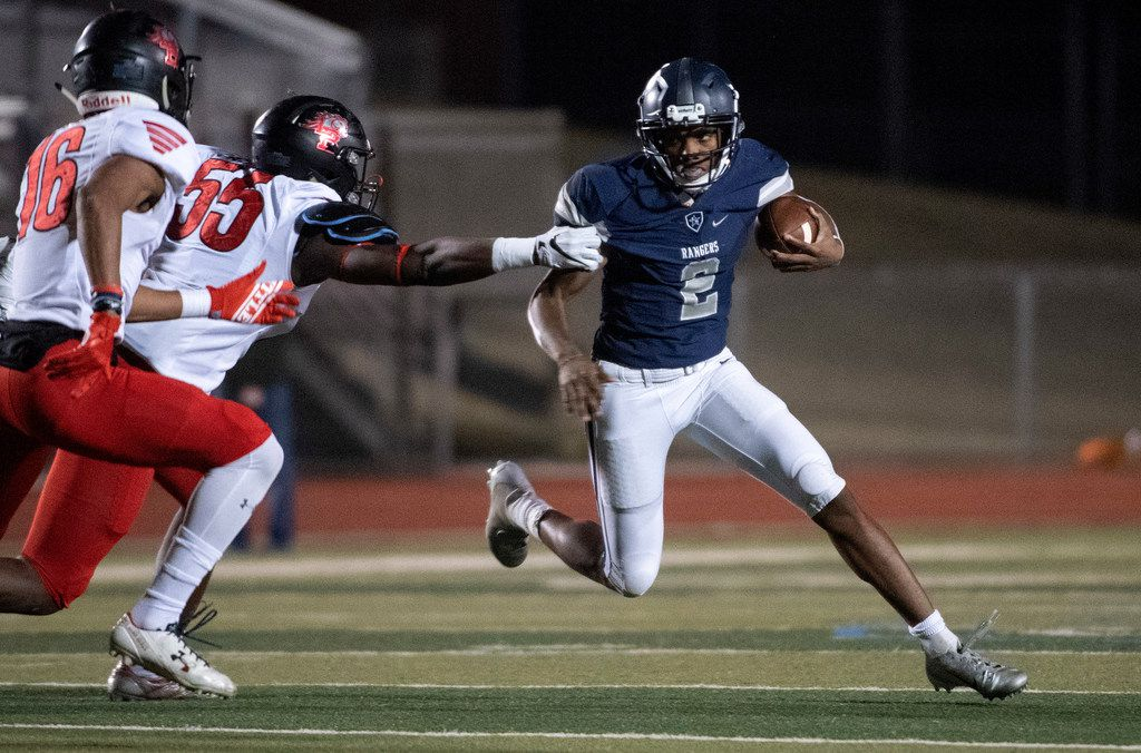 Frisco Lone Star junior quarterback Julian Larry (2) tries to avoid the tackle of Mansfield Legacy defensive lineman David Abiara (55) during the first half of a bi-district round high school football playoff game Friday, November 16, 2018 at Memorial Stadium in Frisco, Texas. (Jeffrey McWhorter/Special Contributor)