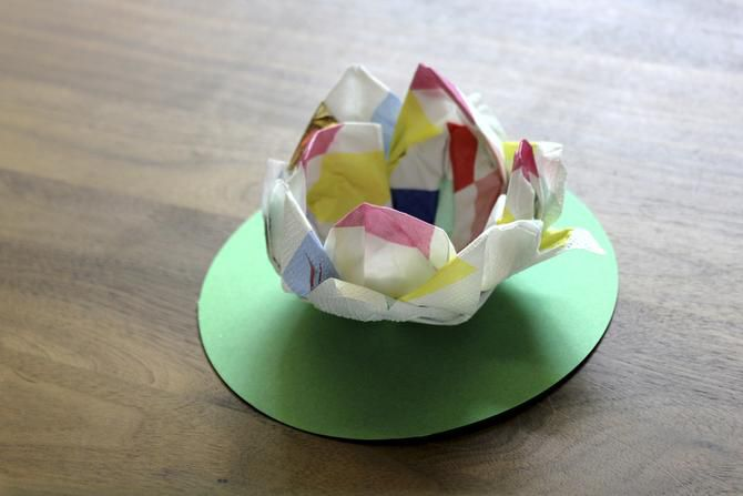 THERE ARE MANY  different designs for origami flowers. This one looks like a lotus.