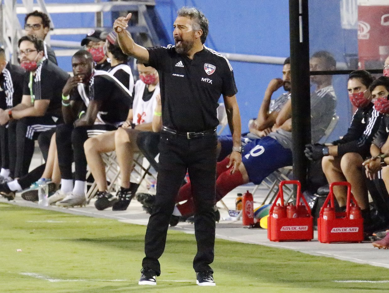 FC Dallas Interim Head Coach Marco Ferruzzi shouts instruction during the first half as FC Dallas hosted Sporting Kansas City at Toyota Stadium in Frisco on Wednesday, September 29, 2021. (Stewart F. House/Special Contributor)