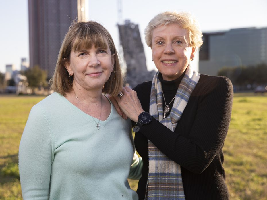 Jane Spillman Wansley (left) and Ann Spillman, daughters of the late Pat Y. Spillman of Fisher and Spillman, the architect group that designed the building that has become known as the Leaning Tower of Dallas, pose in front of the partially demolished tower on Feb. 27, 2020 in Dallas. (Juan Figueroa/The Dallas Morning News)